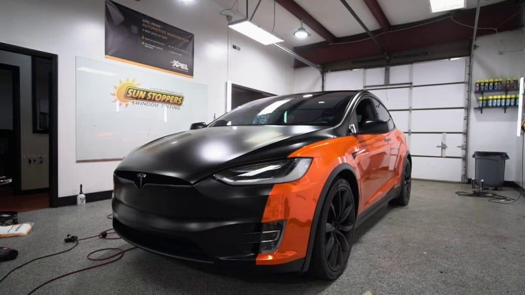 a black and orange tesla with paint protection
