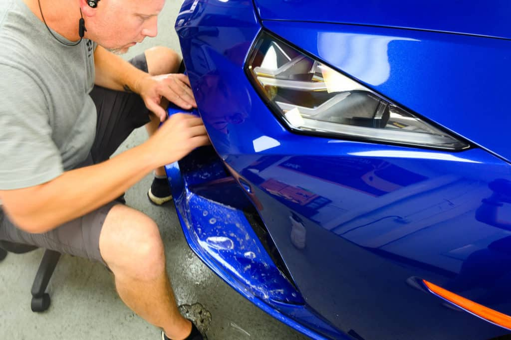 a blue sports car with fresh paint protection film